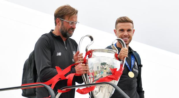 Liverpool's Jurgen Klopp, left, and Jordan Henderson will be Qatar-bound in December for the Club World Cup. (Dave Howarth/PA)