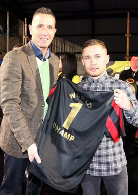 Stephen Baxter presents Crusaders' No.1 fan Carl Frampton with a shirt