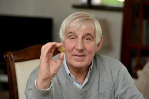 Eric Bowyer at home in Lisburn with one of his medals from his time at Linfield