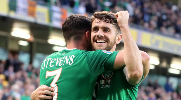 Republic of Ireland's Robbie Brady (right) celebrates scoring his side's second goal of the game with Enda Stevens (Niall Carson/PA)