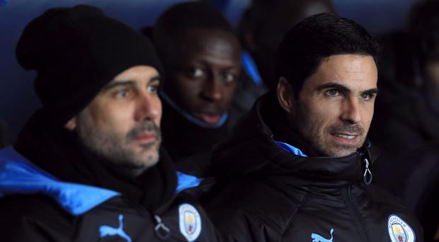 Manchester City manager Pep Guardiola (left) has no news on the future of assistant coach Mikel Arteta (Mike Egerton/PA)