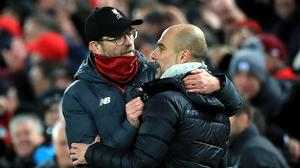 Pep Guardiola (right) will congratulate Jurgen Klopp (left) when they meet at the Etihad Stadium (Peter Byrne/PA).