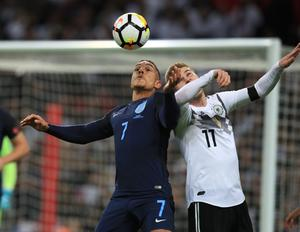 Werner, pictured in an aerial challenge with England's Jake Livermore during a friendly international at Wembley (PA)