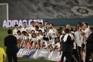 Bale (third from right) was not prominent as Real celebrated winning the title (Bernat Armangue/AP)