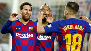 Lionel Messi kept his cool from the spot to give Barcelona all three points at the Nou Camp (Joan Monfort/AP)