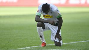 Borussia Moenchengladbach's Marcus Thuram takes a knee after scoring the first of two goals against Union Berlin in the Bundesliga (Martin Meissner, AP).