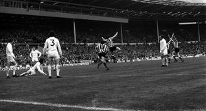 Leeds players, including Trevor Cherry (number three), watch Ian Portersfield score the only goal in the 1973 FA Cup final (PA)