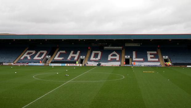 Rochdale have issued a life-time stadium ban to an Oldham supporter who ran onto the pitch (Clint Hughes/EMPICS Sport)