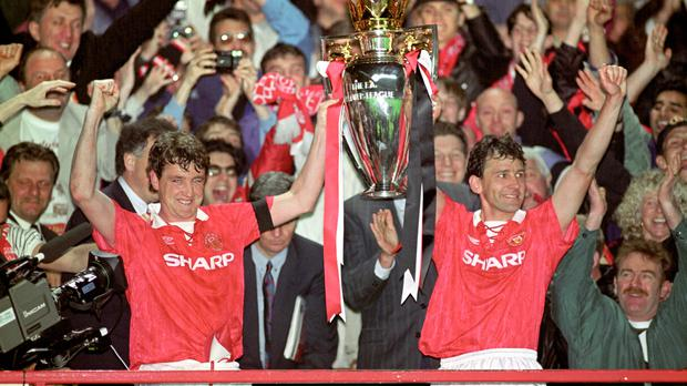 Steve Bruce and Bryan Robson lift the Premier League (Malcolm Croft/PA)