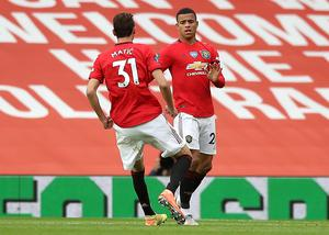 Manchester United's Mason Greenwood, right, got the equaliser (PA)