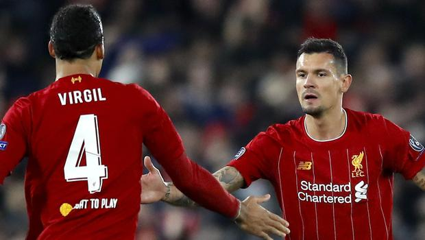 Liverpool's Dejan Lovren (right) celebrates scoring his side's first goal of the game with team mate Liverpool's Virgil van Dijk during the UEFA Champions League Group E match at Anfield, Liverpool.