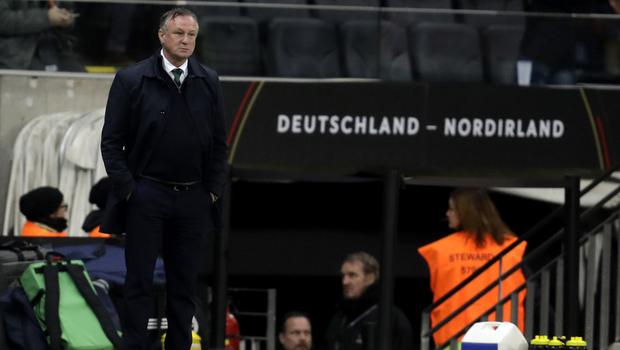 Michael O'Neill's Northern Ireland side endured a tough night in Frankfurt (Michael Probst/AP).