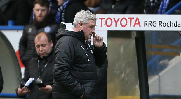 Newcastle manager Steve Bruce, right, during the FA Cup third round match at Rochdale (Richard Sellers/PA)