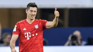 Bayern Munich's Robert Lewandowski scored a hat-trick against Schalke (Martin Meissner/AP)