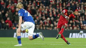 Liverpool face Everton on June 21 (Richard Sellers/PA)