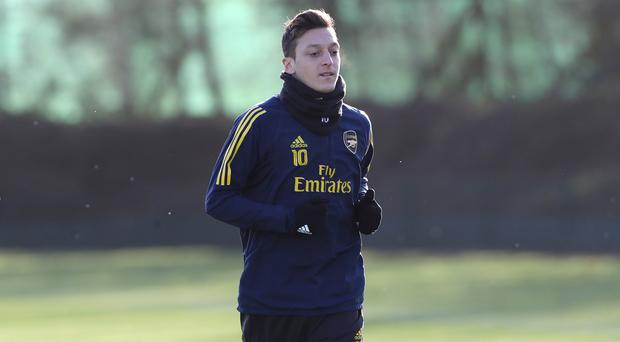 Mesut Ozil has been linked with a move away from Arsenal (Bradley Collyer/PA)