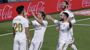 Real Madrid's Marco Asensio celebrates with his teammates (Manu Fernandez/AP)