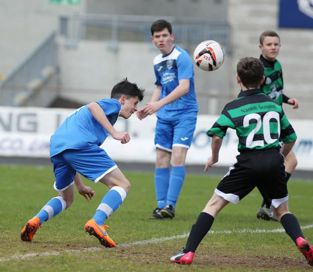 Head of the class: St Columb's College's Cahir McMonigle (right) scores the opening goal against St Joseph's (Derry)