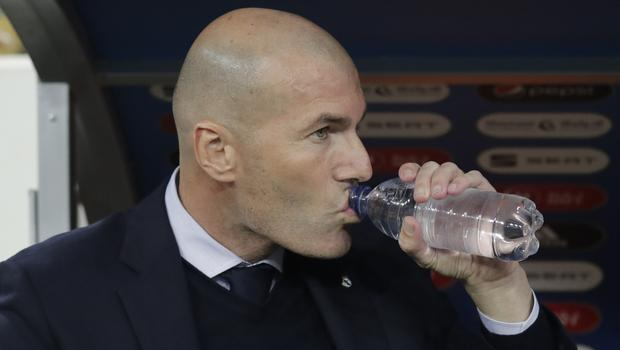 Real Madrid head coach Zinedine Zidane is ready to take on Barcelona under new boss Quique Setien (Hassan Ammar/AP)
