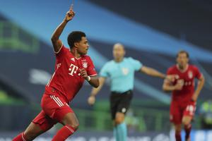 Serge Gnabry celebrates after scoring against Lyon (Miguel A Lopes/AP)