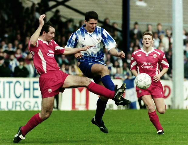 Cancelled out: Portadown's Phillip Major and Glenavon's Stephen McBride battle during the 1994 stalemate that handed Linfield the title