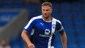 Ian Evatt is the manager of National League leaders Barrow (Tim Goode/PA).