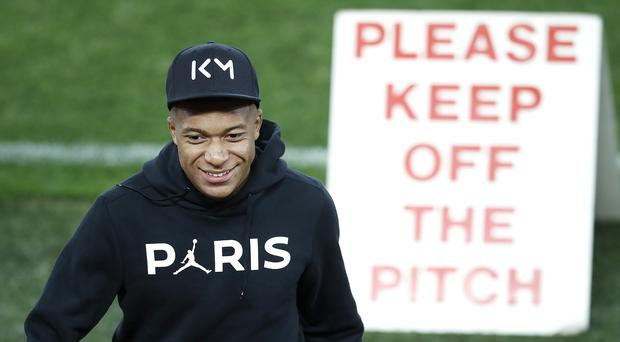 Kylian Mbappe is being linked with a move (PA)