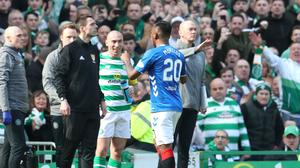 Rangers' Alfredo Morelos leaves the pitch after being sent off as Celtic captain Scott Brown watches on, greatly amused.