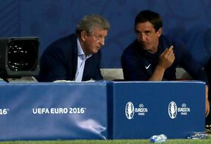 Gary Neville, right, also left his role as a coach following Hodgson's departure (Nick Potts/PA)