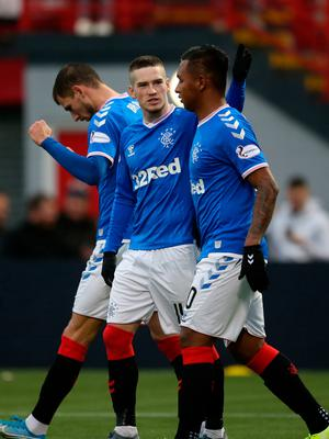 Star turn: Ryan Kent celebrates with Alfredo Morelos after sealing the victory