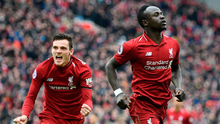 Title charge: Andy Robertson and Sadio Mane celebrate against Chelsea on Sunday