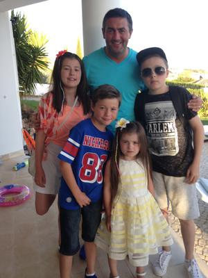 Happy family: Peter Hutton with his children