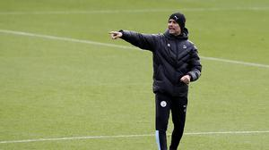 Pep Guardiola is preparing Manchester City to face Fulham this weekend (Martin Rickett/PA)