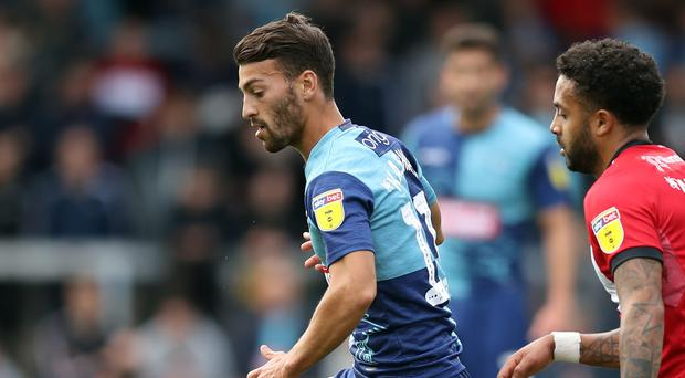 Wycombe striker Scott Kashket, left, has been charged with a breach of Football Association betting rules (Andrew Matthews/PA)