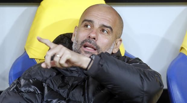 Manchester City boss Pep Guardiola was impressed by his side's display in Ukraine (Efrem Lukatsky/AP).