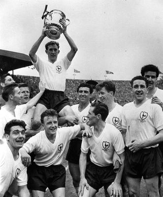 Double top: Spurs captain Danny Blanchflower with the cup in 1961