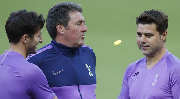 Mauricio Pochettino, right, does not see Tottenham as one of the favourites to win the Champions League (Thanassis Stavrakis/AP)