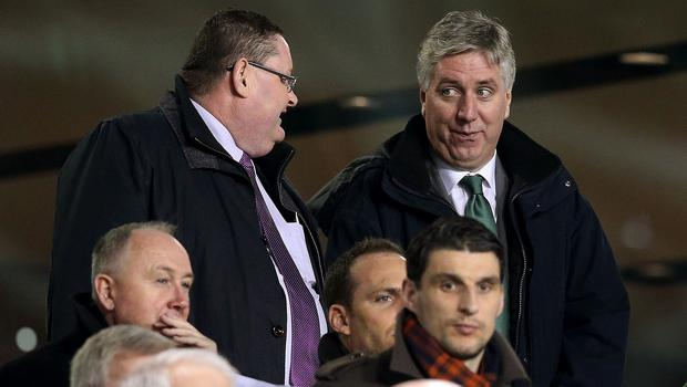John Delaney, right, has been backed to continue as the Football Association of Ireland chief executive