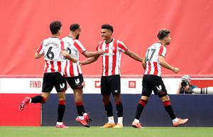 Brentford's Ollie Watkins, second right, has scored 25 league goals this season (Tim Goode/PA)