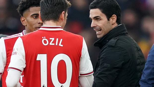 Mikel Arteta (right) appears to have got the best out of Mesut Ozil (John Walton/PA)