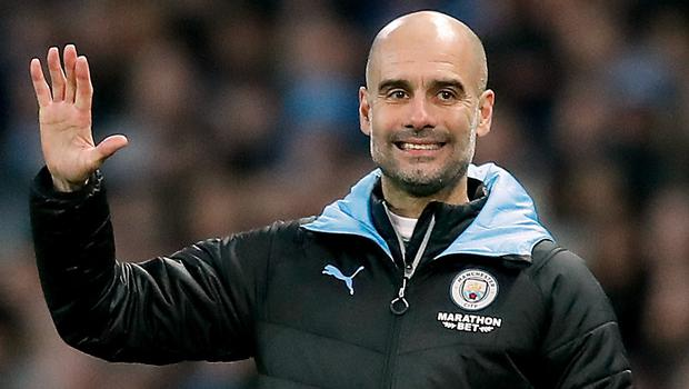 Pep Guardiola is proud of his team despite their failure to keep pace with Liverpool (Martin Rickett/PA)
