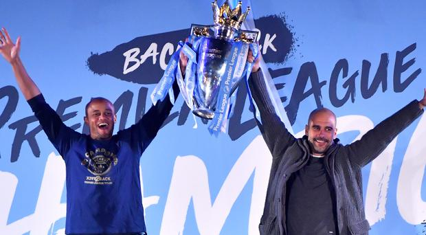 Vincent Kompany, left, believes Pep Guardiola is still the man to take Manchester City forward (Anthony Devlin/PA)