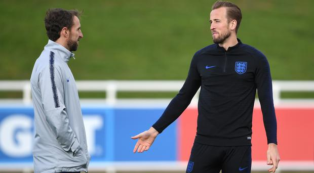 Gareth Southgate, left, is hoping Harry Kane will be fit for the Nations League semi-final (Joe Giddens/PA)