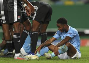 Manchester City's Raheem Sterling looks crestfallen at the end of the Champions League quarter-final soccer match between Lyon and Manchester City in Lisbon (Miguel A. Lopes/Pool via AP).