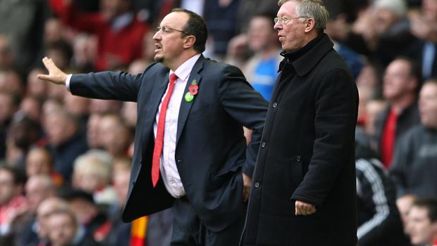 Rafael Benitez (left) went head to head with Sir Alex Ferguson during his time in charge of Liverpool. (Mike Egerton/EMPICS Sport)