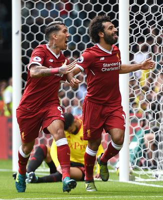 Liverpool's Mohamed Salah (right) and Roberto Firmino have been outstanding this season