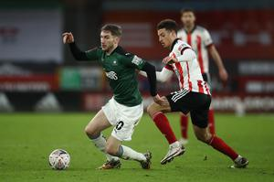 Plymouth's Danny Mayor (left) and Sheffield United's Ethan Ampadu battle for the ball (Tim Goode, PA).