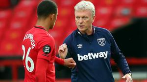 West Ham manager David Moyes, (pictured right) with Manchester United's Mason Greenwood, is relieved he has avoided a final-day relegation decider.