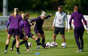 Neville's England face Scotland in their World Cup opener on June 9 (John Walton/PA).