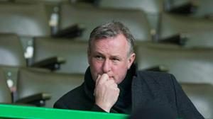 Chris Sutton views Northern Ireland manager Michael O'Neill as an ideal replacement for Neil lennon at Celtic.